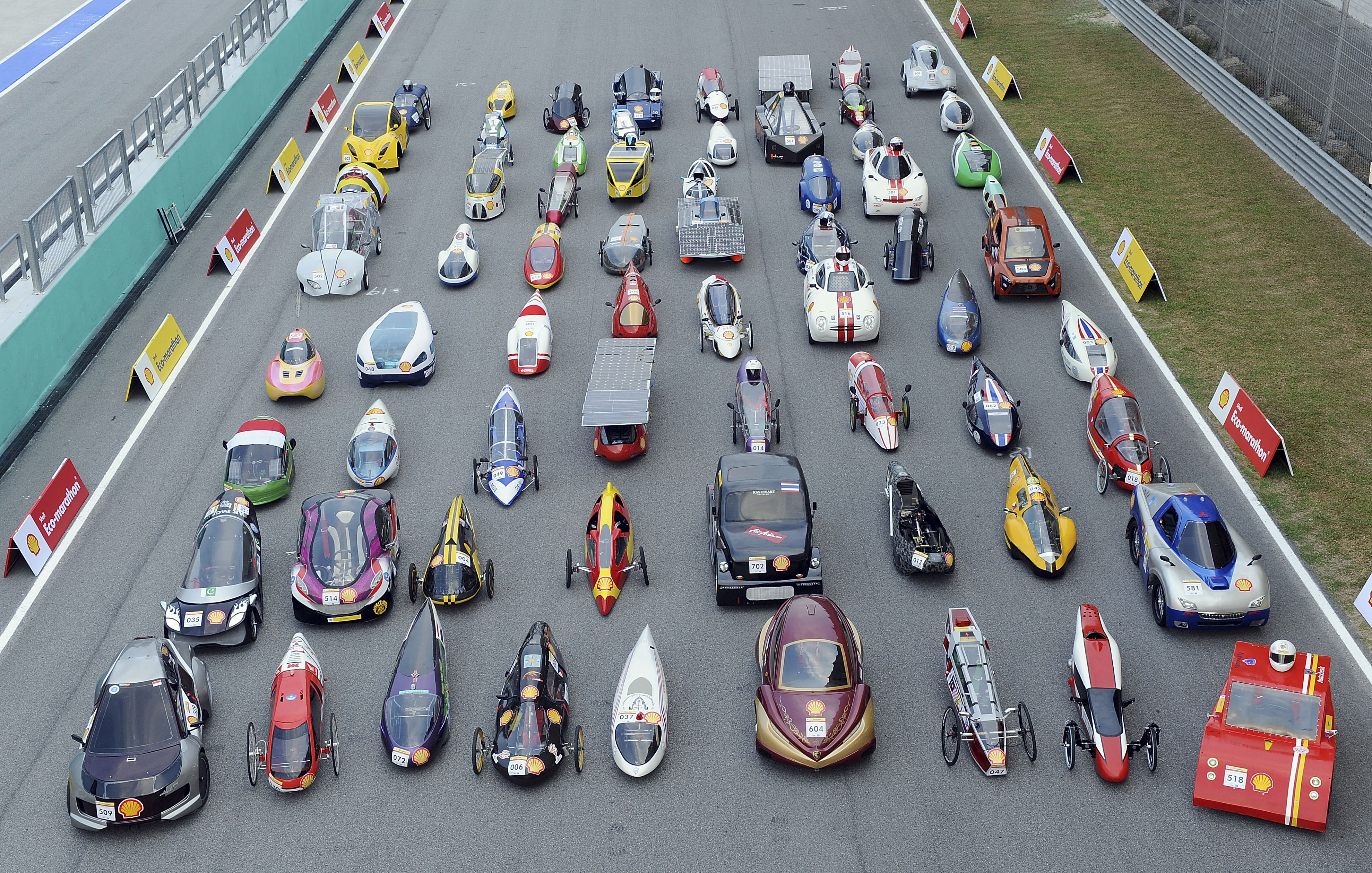 Shell Eco-marathon Asia 2011 In this handout image provided by Shell via AP Images, cars are lined up on the track for a group photo during registration day for the Shell Eco-marathon energy efficiency challenge at Sepang Internation Circuit in Sepang, Malaysia, Wednesday, July 6, 2011. Teams from all over Asia arrived for test day while their cars were put through technical and safety checks to make ready for the ensuing challenge. (Abdul ghani khan/Shell via AP Images