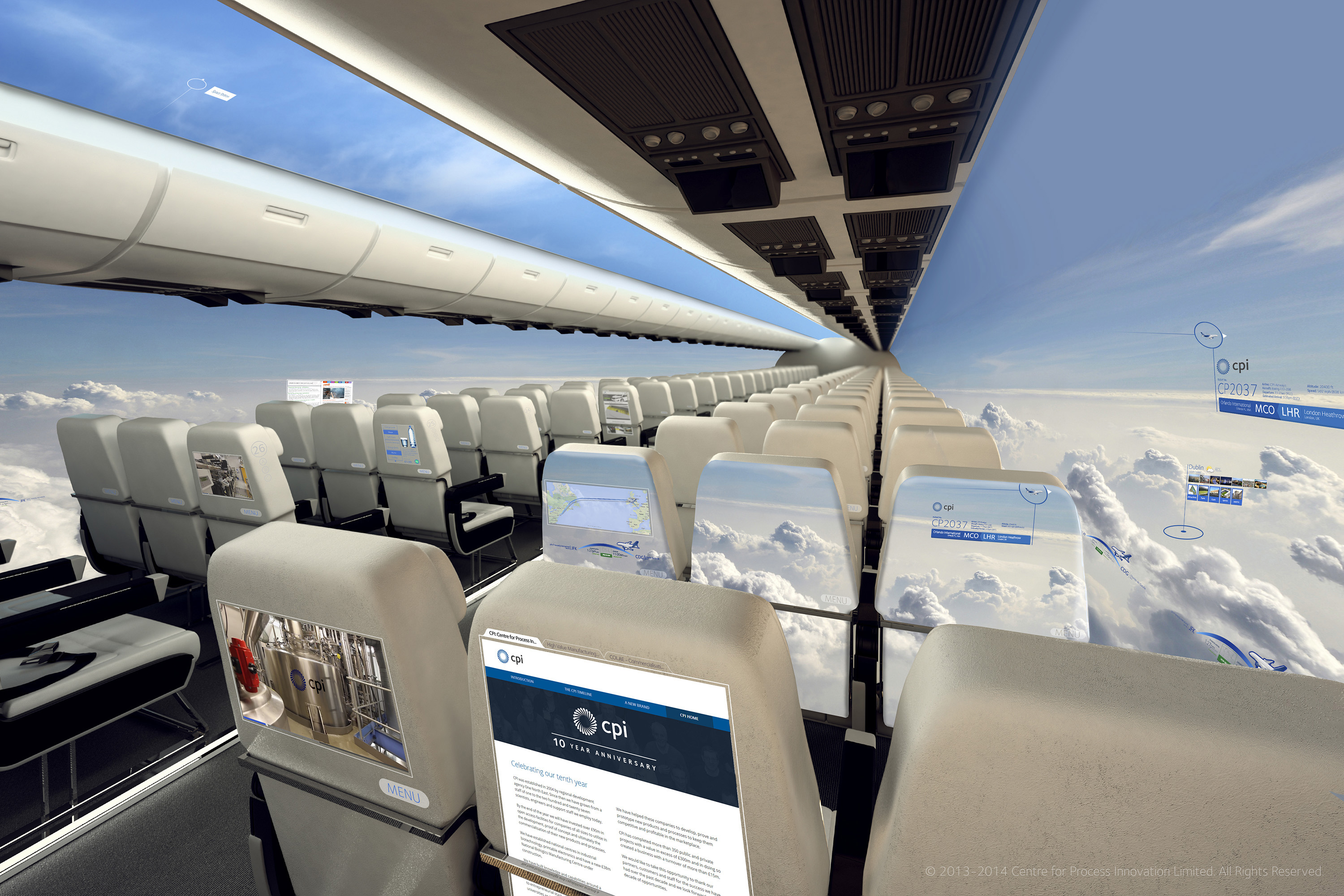 Aircraft cabin concept surrounded by the panoramic views of the windowless aircraft and showing the possible touchscreen and interactive entertainment offered by the wall and seatback displays.