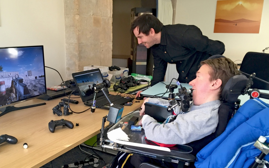 Image of Tom Clarke at SpecialEffect working with a client, Tom