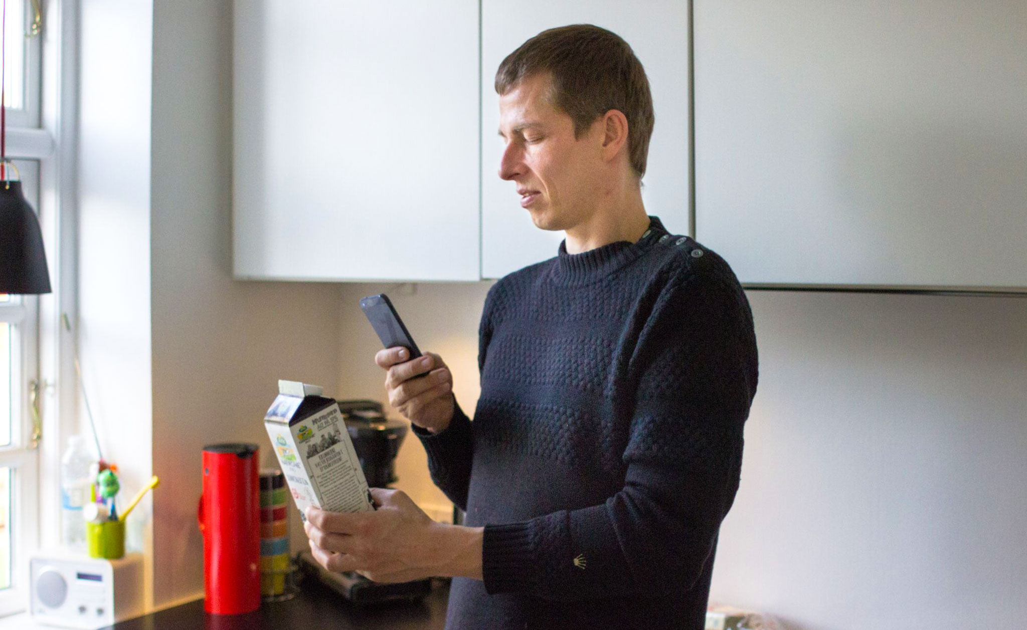 Image of a visually impaired user using the Be My Eyes App to check the expiration date of an item