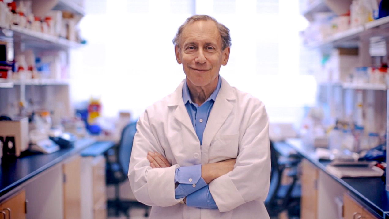 Photograph of Robert S. Langer, chemist, in the laboratory. The image is from a video about him and his work, entitled: Robert Langer BioTech Awards Video.