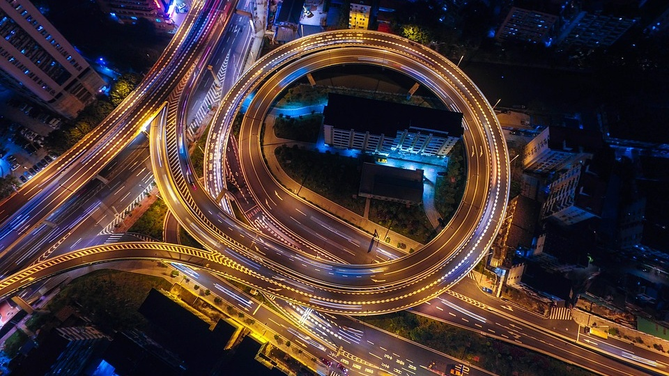 Image of several roads at night taken from above.