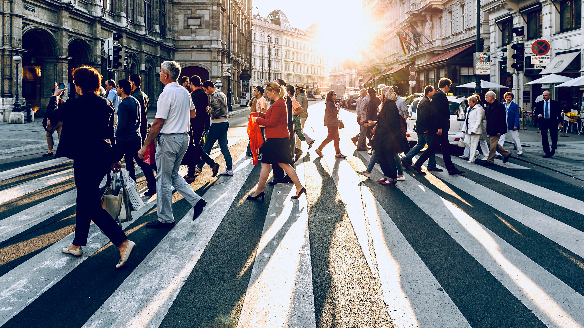 Image of a crowd of people walking over a crossing