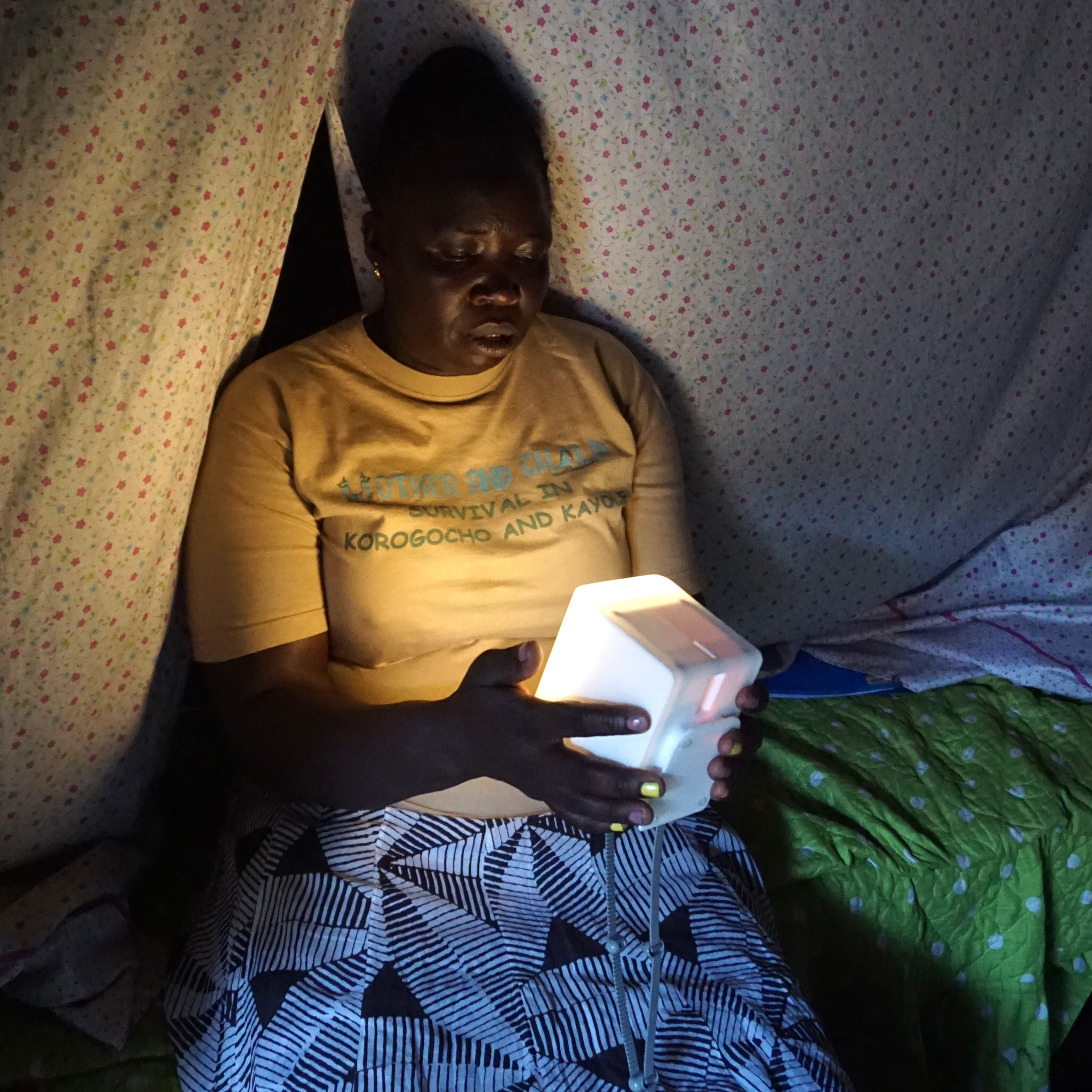 Image of a woman named Rose sitting with a nowlight device.