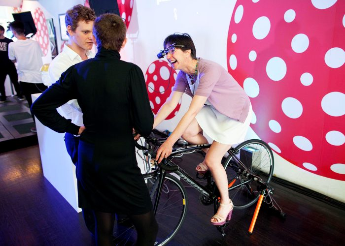 Guest riding AR bike at the 2013 QE Prize celebration at the Tate Modern