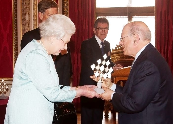 Her Majesty The Queen presenting the QE Prize trophy to Bob Kahn