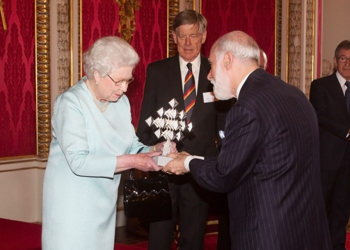 Her Majesty The Queen presenting the QE Prize trophy to Vint Cerf