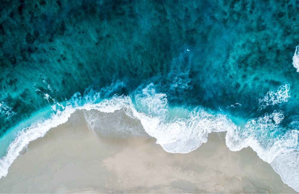 A photo taken by a drone looking down at a beach.