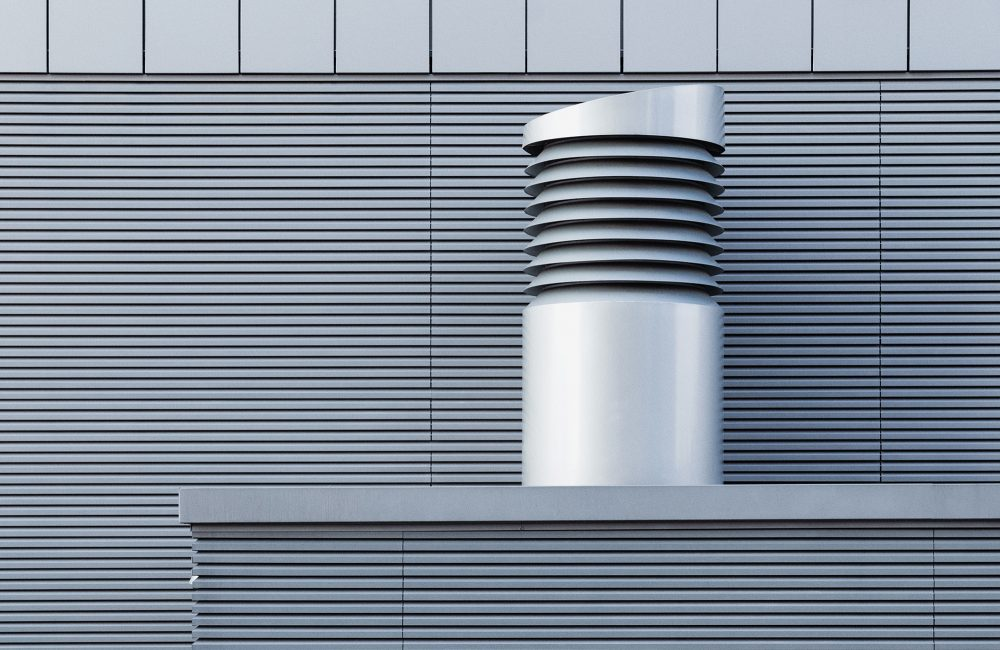 A grey rooftop ventilator