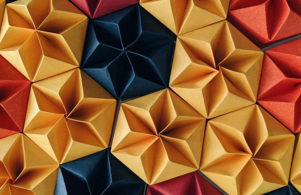 A grid of coloured origami structures folded into hexagons.